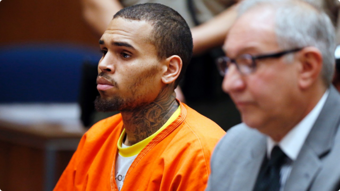 031814-shows-106-park-buzz-chris-brown-court-orange-jumpsuit