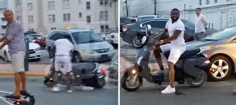 adrien-broner-crashes-his-scooter-into-a-parked-car-in-miami-video-HipHopSince1987.com-2014 Adrien Broner Crashes His Scooter Into A Parked Car in Miami (Video)