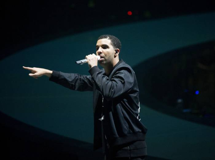drake on stage Drake Cancels 2014 Wireless Festival Performance, Kanye West To Fill In