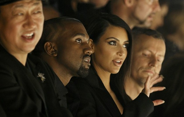 1411681861330_wps_28_TV_personality_Kim_Kardas-e1411875192622 Kanye West & Kim Kardashian Get Boo'd By Hecklers At Paris Fashion Show (Video)