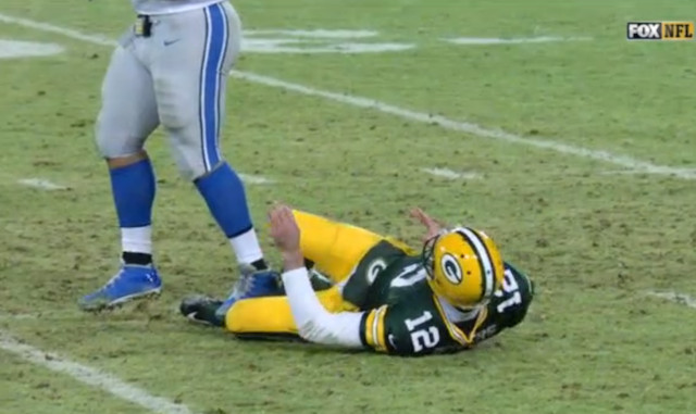 Rodgers-Suh-ankle-lions-packers-1 Detroit Lions DT Ndamukong Suh Has Been Suspended For The NFL Wild Card Weekend