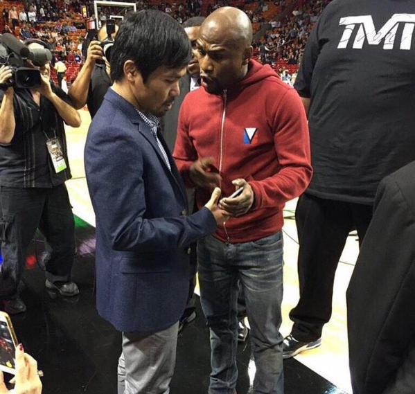 B8Z5-giCEAAgTYN Floyd Mayweather & Manny Pacquiao Exchange Numbers At The Bucks vs. Heat Game In Miami (Photos)