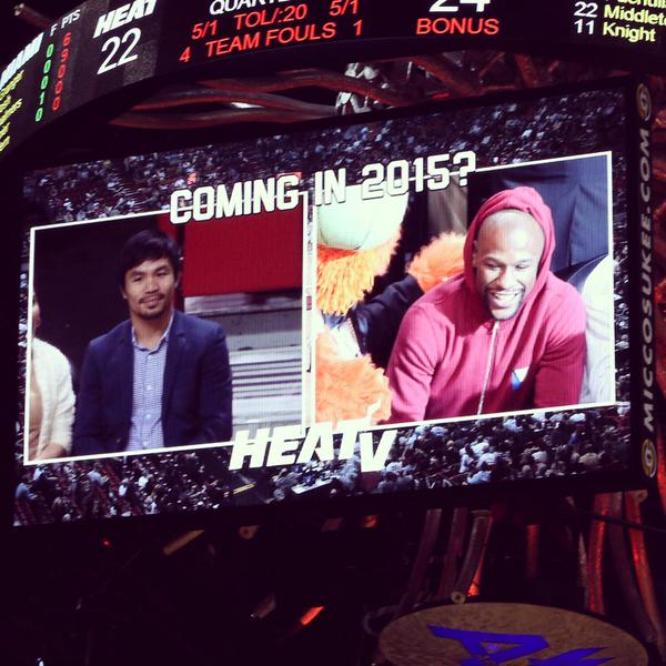 floyd Floyd Mayweather & Manny Pacquiao Exchange Numbers At The Bucks vs. Heat Game In Miami (Photos)