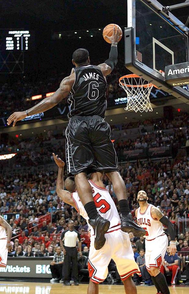 bron-dunk29_1314513c Lebron James JUMPS OVER (not dunk on) BUT OVER Bulls Player John Lucas (Video)