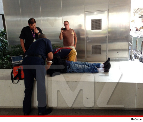 0719-kanye-west-airport-tmz-3 Kanye West Flexes On Yet Another Paparazzi (Video)
