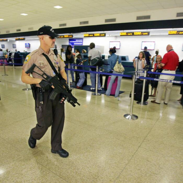 Cop-found-punching-Black-lady-in-the-face-at-Miami-airport-terminal Cop found punching Black lady in the face at Miami airport terminal